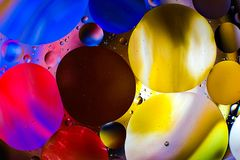 Colorful background from water drops. And oil Stock Images