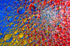 Colorful background from water drops. And oil Royalty Free Stock Photos