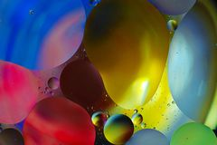 Colorful background from water drops. And oil Stock Photography