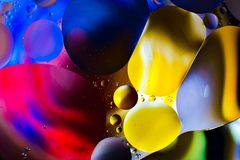Colorful background from water drops. And oil Royalty Free Stock Photography