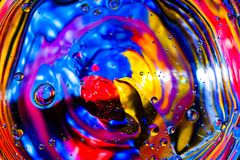 Colorful background from water drops. And oil Stock Photos