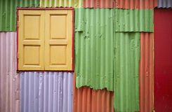 Colorful background. Colorful zinc wall with wooden window, use as background stock photo