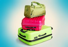 Colorful suitcases and backpack on light. Colorful backpack suitcase suitcases red large objects Stock Image