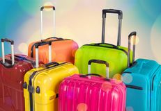 Colorful suitcases and backpack on wall background. Colorful backpack suitcase suitcases red large objects Royalty Free Stock Image