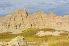 Colorful Badlands Formations Against Stormy Skies Royalty Free Stock Photography
