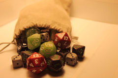 A colorful bag of dice. stock images