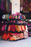 Colorful bags, pillows and pillowcases. LIMA, PERU - AUGUST 11, 2011: Colorful bags, pillows and pillowcases on one of the many so-called Inca Markets on August Royalty Free Stock Photos