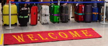 Colorful bags, rainbow journey. Welcome, red carpet. Stock Image
