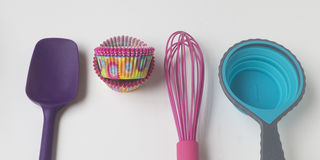 Colorful baking. Bright baking utensils and cupcake papers Royalty Free Stock Images