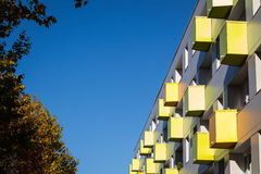 Colorful balconies on apartment building Stock Photos