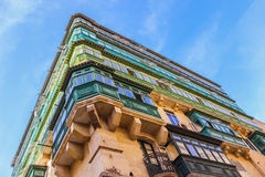 Colorful balconies in Valetta. Corner of the house with rows of colorful balconies in Valletta, Malta Royalty Free Stock Image