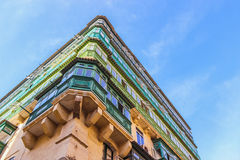 Colorful balconies in Valetta. Corner of the house with rows of colorful balconies in Valletta, Malta Stock Images