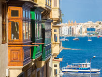 Colorful balconies of Valletta with tourist boat - Malta. Colorful balconies of Valletta with tourist boat at Malta Stock Photos