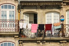 Colorful balcony with clothes hanging. Porto. Portugal Stock Photo