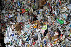 Colorful bales of paper at recycling center. Modern recycling facilities flatten and bale paper from consumers and industry prior to shipping Royalty Free Stock Photos