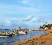 Colorful Bali Fishing Boats on the Beach at Sanur, Indonesia. stock photo