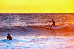 Colorful Bali surfing scene Royalty Free Stock Image