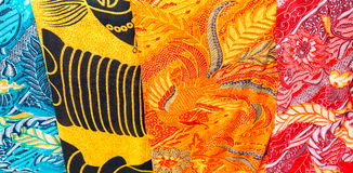 Colorful balinese cloth for sale, Abstract fabric texture backgr Royalty Free Stock Images