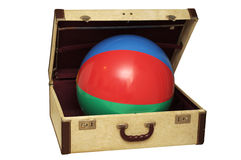 Colorful ball in an old suitcase Royalty Free Stock Photography