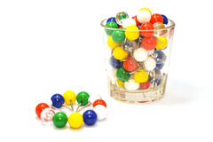 Colorful ball pins isolated. A cup of colorful ball pins Stock Photography