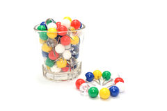 Colorful ball pins isolated. A cup of colorful ball pins Royalty Free Stock Photography
