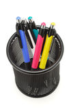Colorful ball point pens in black container. Multicolor ball point pens in black container on white stock photography