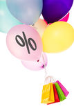 Colorful ballons with a percentage sign, shopping bags Royalty Free Stock Photos