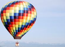Colorful balloon. Colorful hot air balloon against clear sky floating over the rockies Stock Image