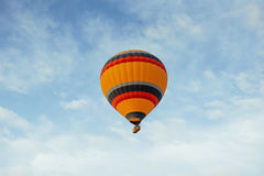 Colorful balloon on the blue sky. Stock Photo