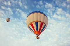 Colorful balloon on the blue sky. Stock Image