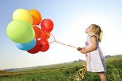 Colorful balloon girl Stock Image
