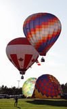 Colorful balloon liftoff Royalty Free Stock Photos