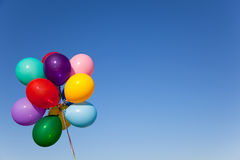 Colorful Balloons. A group of colorful balloons with blue sky background stock photos