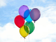 Colorful Balloons. A rainbow of colorful balloons against a beautiful springtime sky Stock Photography