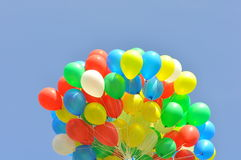 Colorful balloons. Colorful bunch of balloons floating in blue sky Stock Images