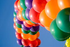 Colorful Balloons. Colorful, festive balloons against a bright blue sky Royalty Free Stock Images