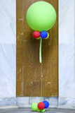 Colorful Balloons. A huge green balloon with other colorful balloons attached to it Royalty Free Stock Photos