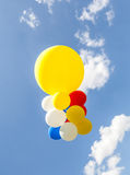 Colorful balloons against the blue sky Stock Photos