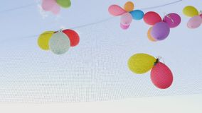 Colorful balloons attached to a metal grid stock video footage