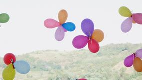 Colorful balloons attached to a metal grid stock footage