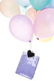 Colorful balloons, bag with heart, shopping Stock Photography