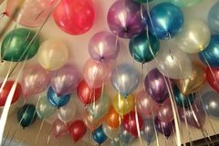 Colorful balloons, balloons with helium, under the ceiling, birthday, holiday stock images