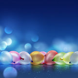 Colorful balloons. On blue background blur Royalty Free Stock Image