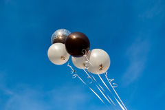 Colorful balloons in blue sky. Background Royalty Free Stock Image