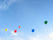 Colorful balloons on blue sky background. Background of colorful balloons flying in the blue sky Royalty Free Stock Image