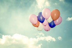Colorful balloons on blue sky background Stock Photo