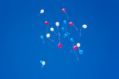 Colorful balloons on a blue sky background. White red blue balloons on a blue sky background white red Royalty Free Stock Photography