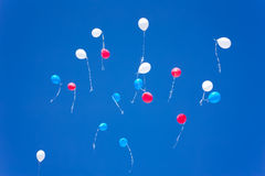 Colorful balloons on a blue sky background. White red blue balloons on a blue sky background white red Royalty Free Stock Images