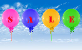 Colorful balloons on blue sky.  Concept of sale message for shop Royalty Free Stock Photography