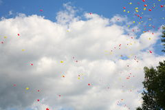 Colorful balloons in blue sky Stock Photos